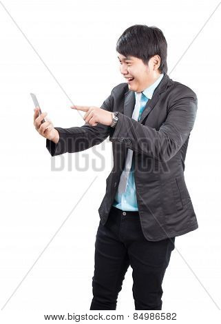 Portrait Of Young Asian Business Man Pointing Hand To Smart Phone With Happiness Emotion Face Isolat