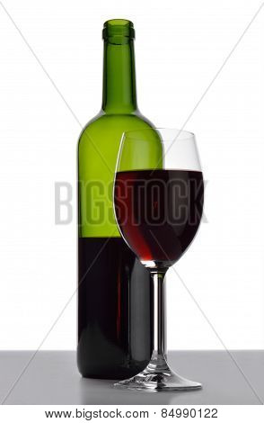 Bottle And Wineglass With Red Wine.