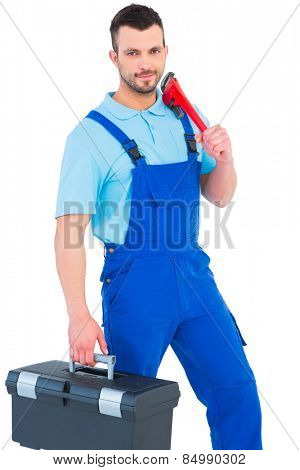 Repairman with toolbox and monkey wrench on white background
