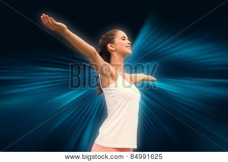Beautiful woman with arms raised against sky against abstract background