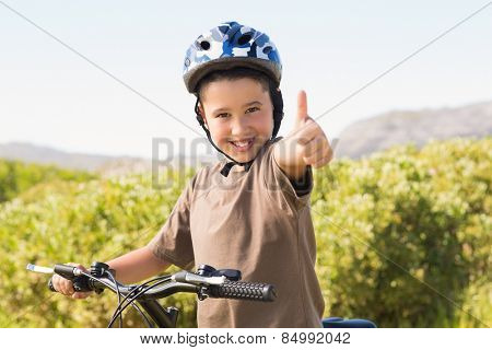 Little boy on a bike ride on a sunny day