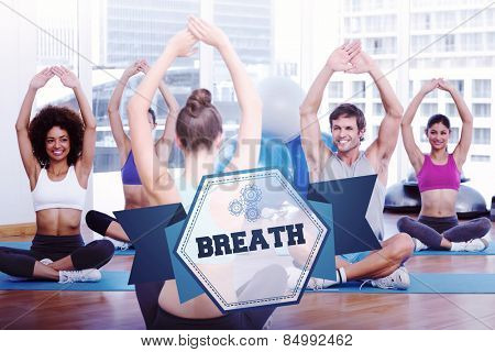 The word breath and people with trainer doing stretching exercises in gym against hexagon