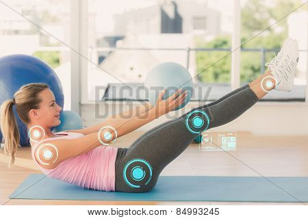 Sporty young woman stretching body in fitness studio against fitness interface