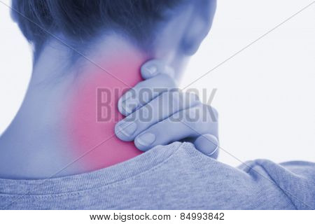 Rear view of woman suffering from neckache against white background