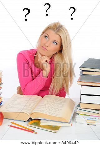 Young Pretty Tired Student Girl With Lots Of Books Thinking. Iso