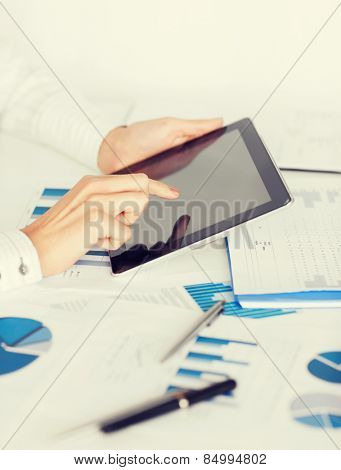 business, office, school and education concept - woman with tablet pc and chart papers