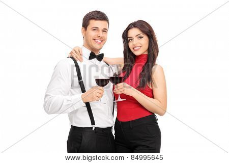 Young couple drinking red wine together isolated on white background