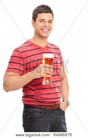 Vertical shot of a casual guy drinking beer isolated on white background