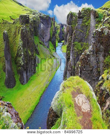 The most picturesque canyon Fjadrargljufur  and the shallow creek, which flows along the bottom of the canyon. Fantastic country Iceland