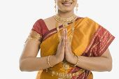 stock photo of nose ring  - South Indian woman greeting with folded hands - JPG