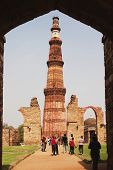 pic of qutub minar  - Tourists at a monument - JPG