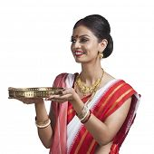 picture of pooja  - Traditional Bengali woman holding pooja thali - JPG
