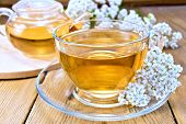 pic of teapot  - Yarrow tea in a glass cup and teapot - JPG