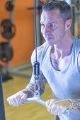 foto of pulley  - man making pulley pushdown standing  - JPG