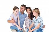 image of lap  - Happy children sitting on parents laps over white background - JPG