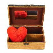 pic of casket  - Plush red heart in a old - JPG