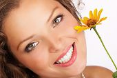 picture of beautiful women  - pretty smiling woman with fresh flower. isolated over white
