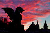 foto of monster symbol  - Vivid sunset sky over silhouette of Famous Dragon bridge - JPG