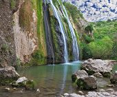 picture of water jet  - Three parallel streams of water running down the steep slope and fall in oval pool - JPG