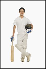 stock photo of cricket shots  - Portrait of a cricket batsman standing with a bat and a helmet - JPG