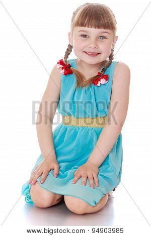 ute little blonde girl with pigtails in that braided ribbon, sit