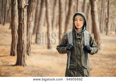 Hiker Young Woman With Backpack Walking In The Pine Forest