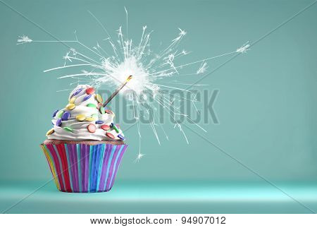 Delicious cupcake with a sparkler for an event celebration.
