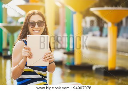 woman take a photo with tablet