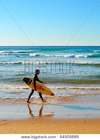 Surfer On The Beach , Portugal