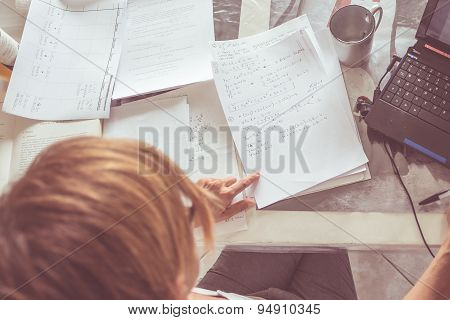 Woman Reading Mathematics Formulas, Directly Above