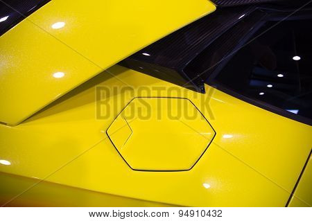 Fuel Cap Of A Yellow Sportscar