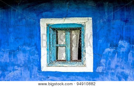 Old Window On A Blue Wall