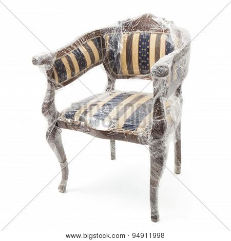Old Chair In Retro Style Packaged In Foil