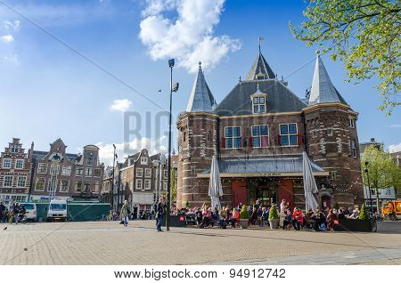Amsterdam, Netherlands - May 7, 2015: People Visit The Waag On Nieuwmarkt Square In Amsterdam.