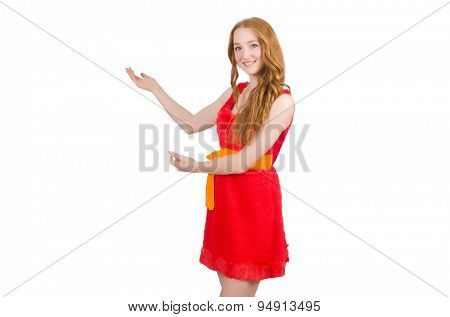 Young beautiful girl in red dress pointing isolated on white