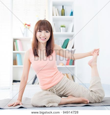 Happy Asian girl stretching and yoga in the morning. Young woman indoors living lifestyle at home.