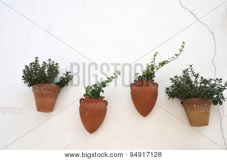 Clay Pots On White Wall