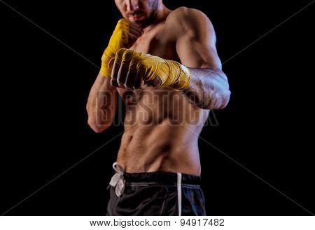 Sportsman Kick Boxer Portrait Against Black Background.