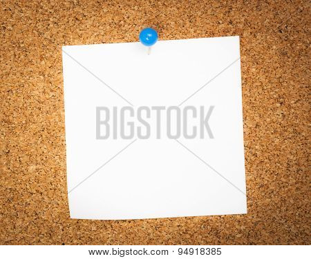 Business card posted on a cork board