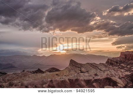 Zabriske Point badlands and Manly Beacon at sunset