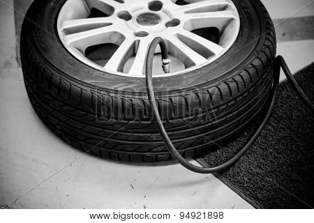 Filling Air Into Car Tire