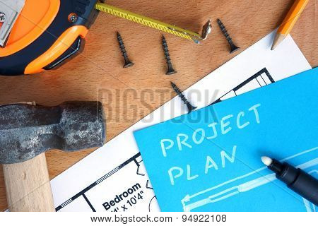 Blue paper with home improvement project plan and tools kit