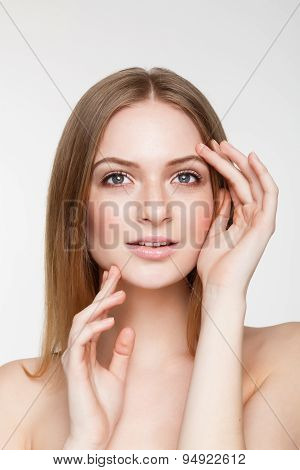 Young Beautiful Woman With Natural Makeup On Grey Background