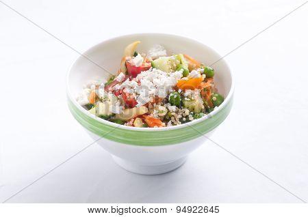 Quinoa And Chickpea Salad With Feta, Cucumber And Tomato