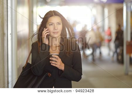 Businesswoman On Phone Walking In The Mall