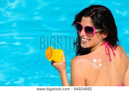 Woman Enjoying Summer With Sun Skin Protection At Swimming Pool