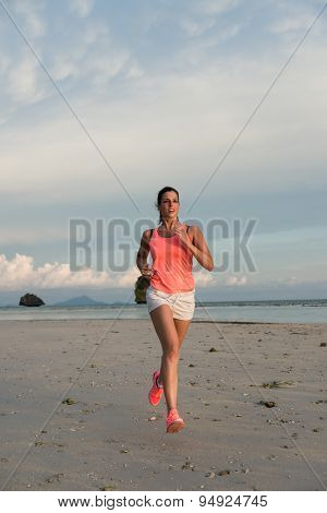 Sporty Woman Running At The Beach