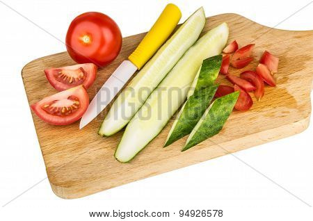 Chopped Tomatoes And Cucumbers On Wooden Cutting Board