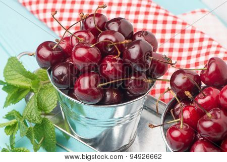 Cherries In Blue Wooden Table