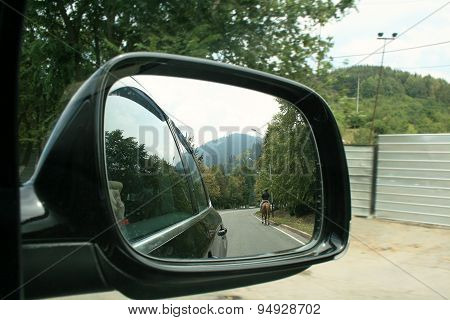 Reflection On Mirror Of The Car